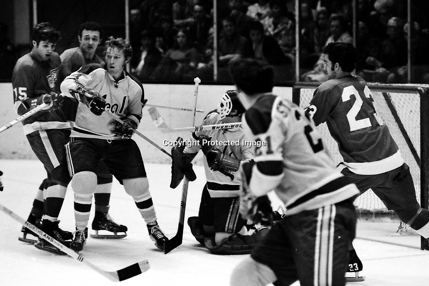 California Golden Seals vs Detroit Red Wings 1971<br />Seals Dick Redmond, Ron Stackhouse, and goalie Chris Worthy. Wings Al Karlander, amd Guy Charron.<br />9photo by Ron Riesterer)