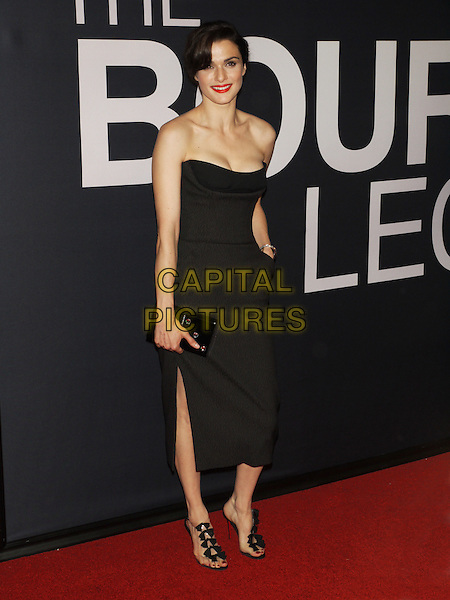 "Rachel Weisz.The World Premiere of ""The Bourne Legacy"" at the Ziegfeld Theatre, New York, NY, USA..July 30th, 2012.full length black dress strapless cleavage clutch bag slit split .CAP/LNC/TOM.©LNC/Capital Pictures."