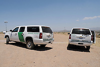 Nogales, Arizona - Two Border Patrol vehicles parked near the international U.S.-Mexico border. The vehicles were part of a caravan that took journalists to the border in an event sponsored by the U.S. Customs and Border Protection agency. This area is near the Border Patrol Nogales station, one of eight in the Tucson Sector, which is the busiest on the U.S.-Mexico border for illegal immigration, drug smuggling and border deaths. Photo by Eduardo © 2012