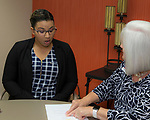 Nicole Barnes, left, gets the details of her scholarship from Board Member Amy Shocket during the Nevada Women's Fund Scholarship distribution, June 20, 2019.