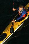Sea Kayaking, kayaker Nigel Foster from above, blur motion,.