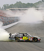14 September 2008--Greg Bifle does a victory burnout after winning the Sylvania 300 at New Hampshire Motor Speedway in Loudon, NH.  (Brian Cleary/bcpix.com)