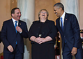 President Barack Obama (R) jokes with Norway Prime Minister Erna Solberg (C) and Sweden Prime Minister Stefan Lofven during an arrival ceremony in the Grand Foyer of the White House in Washington, D.C. May 13, 2016. <br /> Credit: Kevin Dietsch / Pool via CNP