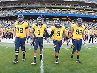 California captains' Mitchell Schwartz, Marvin Jones, D.J. Holt, Trevor Guyton walk to the field for coin toss before the game against USC at AT&T Park in San Francisco, California on October 13th, 2011.  USC defeated California, 30-9.