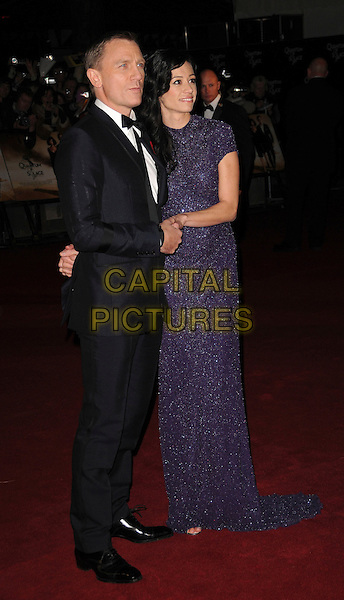 "DANIEL CRAIG & SATSUKI MITCHELL .attending the Royal World Premiere of ""Quantum of Solace"", Odeon West End,  London, England, October 29th 2008..James Bond full length black suit purple sparkly long dress couple bow tie.CAP/CAS.©Bob Cass/Capital Pictures"