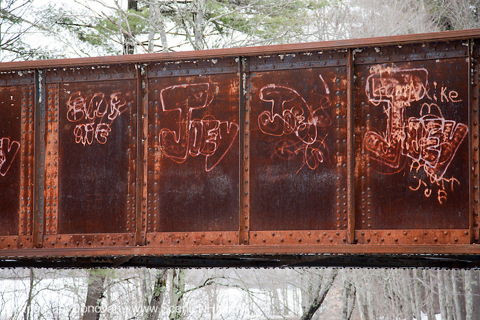 Old railroad bridge on the railroad bed in Fremont, New Hampshire USA which crosses the Exeter River