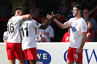 Joe Quigley of Dagenham and Redbridge (R) scores the third goal for his team and celebrates with his team mates during Dagenham & Redbridge vs Hartlepool United, Vanarama National League Football at the Chigwell Construction Stadium on 14th September 2019