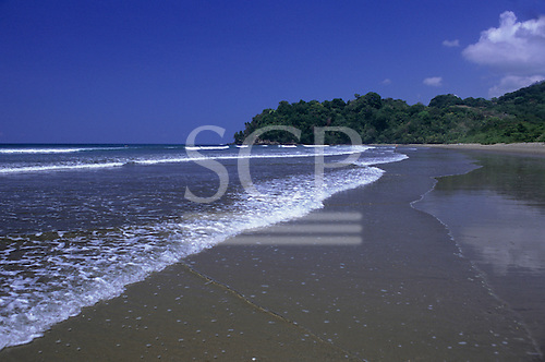 Marino Ballena National Park, Costa Rica. The beach at Punta Uvita with people bathing in the sea.