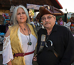 Marti Wright and Craig Larson with Pirates of Reno during the Pirate Crawl held in downtown Reno on Saturday night, August 13, 2016.