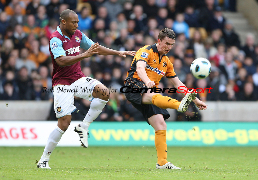 Kevin Foley of Wolves and Danny Gabbidon of West Ham - Wolverhampton Wanderers vs West Ham United, Barclays Premier League at Molineaux, Wolverhampton - 16/10/10 - MANDATORY CREDIT: Rob Newell/TGSPHOTO - Self billing applies where appropriate - 0845 094 6026 - contact@tgsphoto.co.uk - NO UNPAID USE.