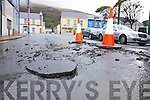 Pressure from flood water in Cahersiveen on Saturday burst up through the road surface, pictured here outside the Community Centre.