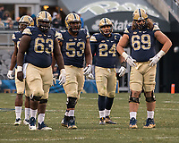 Alex Officer (63), Dorian Johnson (53), James Conner (24), and Adam Bisnowaty (69) get ready to huddle. The Pitt Panthers defeated the Syracuse Orange 76-61 at Heinz Field in Pittsburgh, Pennsylvania on November 26, 2016.