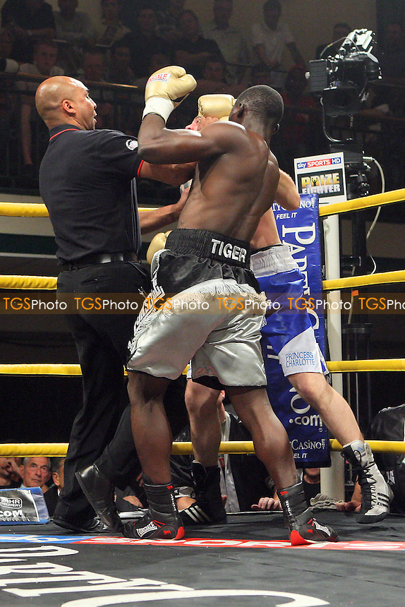 Patrick Mendy (silver/black shorts) defeats Sam Horton in Round One of Prizefighter 'The Super Middleweights' at York Hall, Bethnal Green, promoted by Matchroom Sports / Barry Hearn - 30/06/10 - MANDATORY CREDIT: Gavin Ellis/TGSPHOTO - Self billing applies where appropriate - Tel: 0845 094 6026
