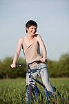 Russia, Voronezh, woman on bike in field