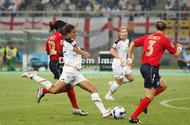 TIANJIN, CHINA - SEPTEMBER 22:  Shannon Boxx of the United States sets to take a shot against England during a Women's World Cup quarterfinal soccer match September 22, 2007 in Tianjin, China.  (Photograph by Jonathan P. Larsen)