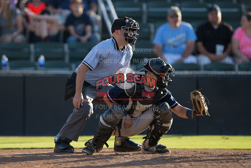 Asheville Tourists catcher Dom Nunez (9) frames a pitch as home plate umpire Grant Conrad looks on during the game against the Kannapolis Intimidators at Intimidators Stadium on June 28, 2015 in Kannapolis, North Carolina.  The Tourists defeated the Intimidators 6-4.  (Brian Westerholt/Four Seam Images)