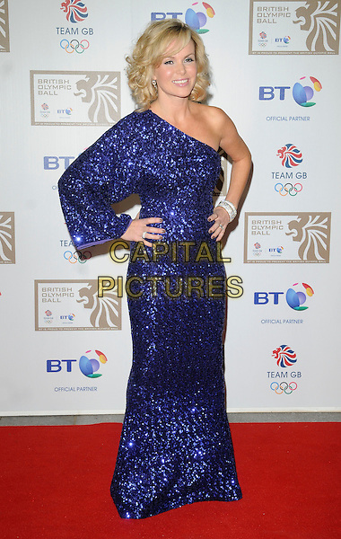 AMANDA HOLDEN .At the British Olympic Ball, Grosvenor House hotel, Park Lane, London, England, 24th September 2010..full length  one sleeve shoulder blue sequined sequin dress long maxi hands on hips sparkly .CAP/CAN.©Can Nguyen/Capital Pictures.