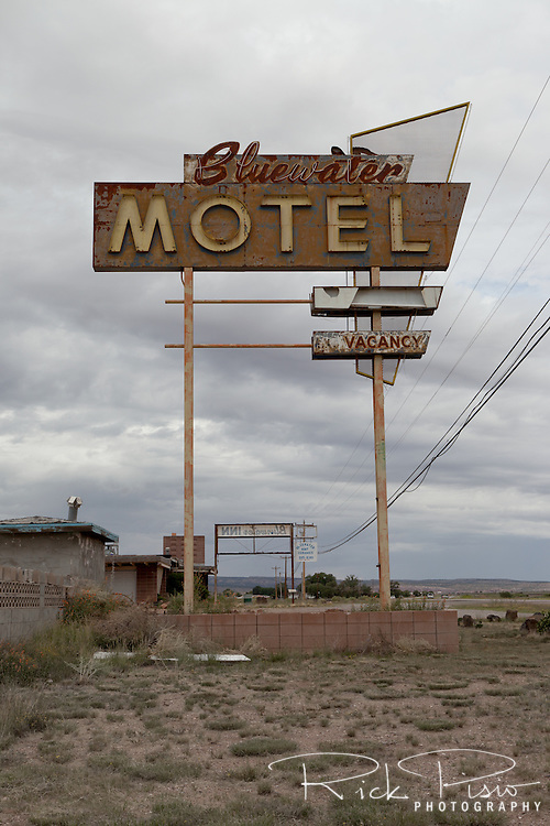Faded and broken neon sign for the Bluewater Motel along Route 66 in Bluewater, New Mexico.