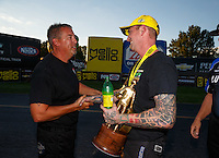 Sep 3, 2016; Clermont, IN, USA; NHRA pro stock driver Aaron Strong (right) is congratulated by Bo Butner as he celebrates after winning the postponed final round from the Seattle race that was rescheduled to run during qualifying for the US Nationals at Lucas Oil Raceway. Mandatory Credit: Mark J. Rebilas-USA TODAY Sports