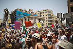 "© Licensed to London News Pictures . 03/06/2016 . Tel Aviv , Israel . Over 100,000 people attend the gay pride parade in Tel Aviv , reported to be the largest such event in the Middle East and Asia . The Israeli government has been accused of using the event as "" pinkwashing "" , marketing the event in order to deflect accusations of poor human rights behaviour . Photo credit: Joel Goodman/LNP"