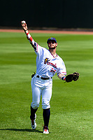 Cedar Rapids Kernels first baseman Trey Cabbage (25) warms up in the outfield prior to a Midwest League game against the Clinton LumberKings on May 28, 2018 at Perfect Game Field at Veterans Memorial Stadium in Cedar Rapids, Iowa. Clinton defeated Cedar Rapids 4-3. (Brad Krause/Four Seam Images)