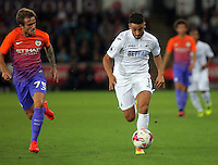 (L-R) Aleix Garcia of Manchester City chases Neil Taylor of Swansea City during the EFL Cup Third Round match between Swansea City and Manchester City at The Liberty Stadium in Swansea, Wales, UK. Wednesday 21 September.