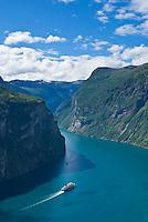 Hurtigruten coastal ferry travels through Geirangerfjord, Norway