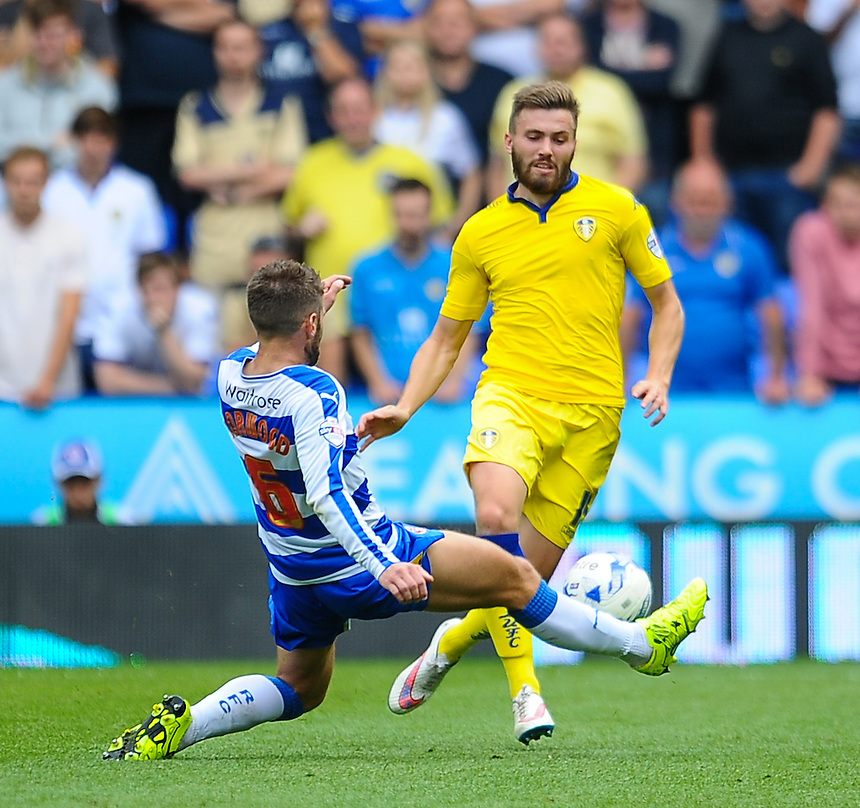 Leeds United's Stuart Dallas evades the tackle of Reading's Oliver Norwood<br /> <br /> Photographer Craig Thomas/CameraSport<br /> <br /> Football - The Football League Sky Bet Championship - Reading v Leeds United - Sunday 16th August 2015 - Madejski Stadium - Reading<br /> <br /> &copy; CameraSport - 43 Linden Ave. Countesthorpe. Leicester. England. LE8 5PG - Tel: +44 (0) 116 277 4147 - admin@camerasport.com - www.camerasport.com