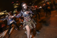 """A woman reenacts dance of zombies from Michael Jackson's """"Thriller"""" during the 41st Annual Halloween Parade. 10.31.2014. Photo by Marco Aurelio/VIEWpress"""