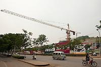 Daytime landscape view of a construction crane at the U Town commercial building construction site near the intersection of Mian Fang Xi Lu and Tong Bai Bei Lu in the Zhōngyuán Qū of Zhengzhou in Henan province.  © LAN