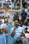 """13 October 2006: Stuart Scott, UNC graduate and ESPN personality, emcees the festivities. The University of North Carolina at Chapel Hill Tarheels held their first Men's and Women's basketball practices of the season as part of """"Late Night with Roy Williams"""" at the Dean E. Smith Center in Chapel Hill, North Carolina."""