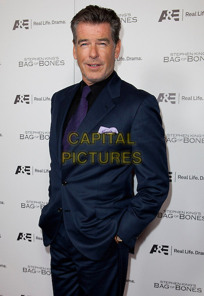 Pierce Brosnan.Stephen King's Bag of Bones Miniseries Premiere on A&E held at Fig and Olive, West Hollywood, California, USA, .8th December 2011..half length hands in pockets  navy blue suit tie shirt .CAP/ADM/ES.©Emiley Schweich//AdMedia/Capital Pictures.