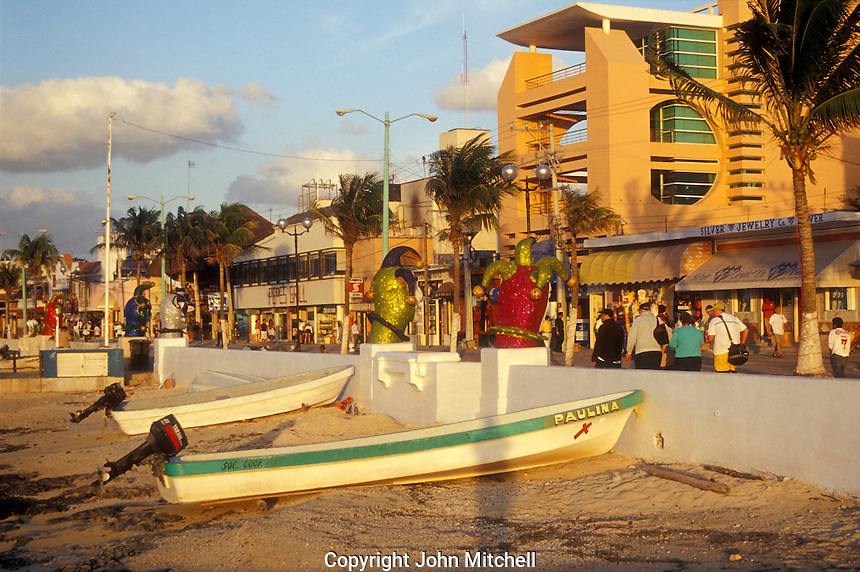 Tourists strolling on the malecon or Avenida Rafael Melgar in San Miguel de Cozumel on the island of Cozumel, Quntana Roo, Mexico