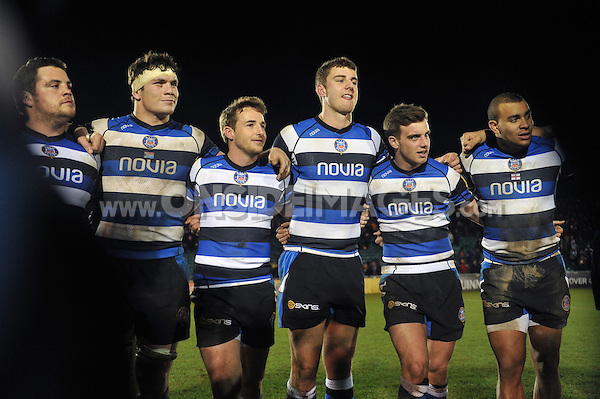 Eusebio Guinazu, Francois Louw, Martin Roberts, Ollie Devoto, George Ford and Jonathan Joseph look on in a huddle after the match. Aviva Premiership match, between Bath Rugby and Harlequins on December 21, 2013 at the Recreation Ground in Bath, England. Photo by: Patrick Khachfe / Onside Images