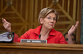 """United States Senator Elizabeth Warren (Democrat of Massachusetts) questions Timothy J. Sloan, Chief Executive Officer and President, Wells Fargo & Company, as he testifies before the US Senate Committee on Banking, Housing, and Urban Affairs as they conduct a hearing entitled, """"Wells Fargo: One Year Later"""" on Capitol Hill in Washington, DC on Tuesday, October 3, 2017. <br /> Credit: Ron Sachs / CNP"""