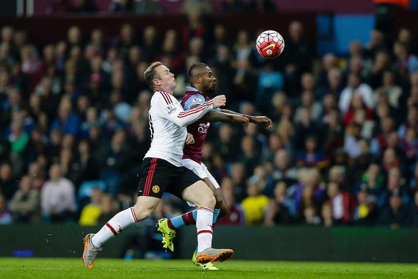 Aston Villa's Leandro Bacuna vies for possession with Manchester United's Wayne Rooney<br /> <br /> Photographer Craig Mercer/CameraSport<br /> <br /> Football - Barclays Premiership - Aston Villa v Manchester United - Friday 14th August 2015 - Villa Park - Birmingham<br /> <br /> &copy; CameraSport - 43 Linden Ave. Countesthorpe. Leicester. England. LE8 5PG - Tel: +44 (0) 116 277 4147 - admin@camerasport.com - www.camerasport.com