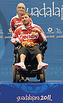 November 16 2011 - Guadalajara, Mexico:  Adam Dukovich and his assisant Brittany Richardson holds up his Gold Medal from Boccia BC2 in the Multipurpose Gymnasium Revolución at the 2011 Parapan American Games in Guadalajara, Mexico.  Photos: Matthew Murnaghan/Canadian Paralympic Committee