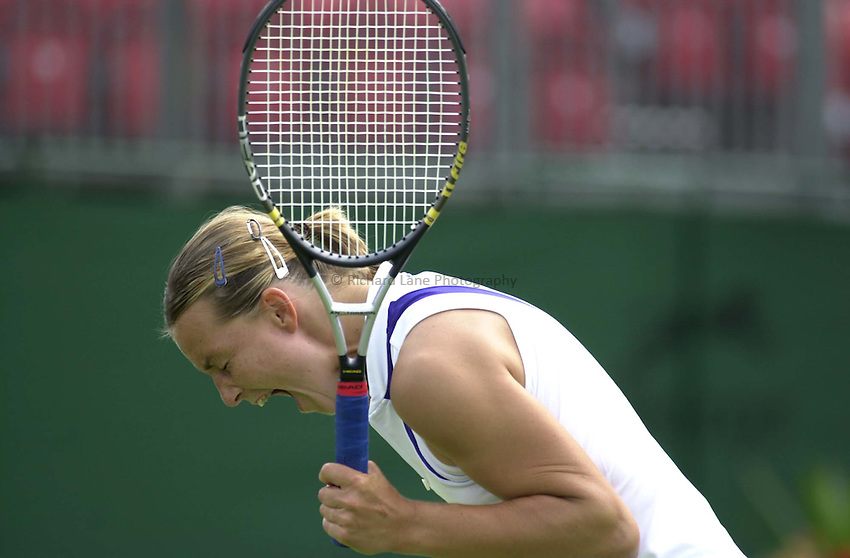 Photo. Richard Lane. .DFS Classic, Edgbaston, Birmingham. 16/6/2000.Anne-Gaelle Sidot is made with herself during the closest of matches.