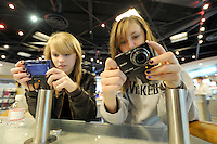 Black Friday shoppers Jenna Mutton, right, and Kaitlyn Wagner, left,  check out the Cyber Shot digital cameras at the Sony store at the King of Prussia Mall looking for after Thanksgiving sales Friday, Nov. 27, 2009 in King of Prussia, PA. (Bloomberg News/Bradley C Bower)