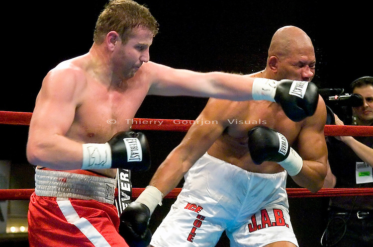 Sultan Ibragimov (l) on the attack against Al Cole  during their 12 Rounds Heavyweight fight at Madison Square Garden in New York City on March 3rd, 2005. Ibragimov won the fight by a 3rd round TKO.