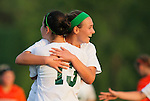 Forest Hills Central's Isabella Fiorenzo is congratulated after scoring a goal by teammate Sam Vinton (13) in a regional final game against Rockford in Kentwood, Michigan on June 4, 2011. (Photo by Bob Campbell)