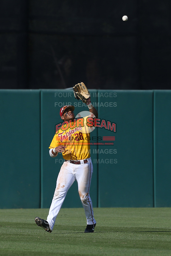 Timmy Robinson #28 of the USC Trojans catches a fly ball during a game against the Northwestern Wildcats at Dedeaux Field on  February 16, 2014 in Los Angeles, California. USC defeated Northwestern, 13-6. (Larry Goren/Four Seam Images)
