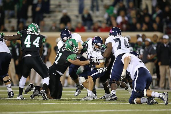 Denton, TX - OCTOBER 29: Aaron Bellazin #44 and Austin Orr #91 of the North Texas Mean Green - University of North Texas Mean Green Football vs Rice University Owls at Apogee Stadium in Denton Texas on October 31, 2012 in Denton, Texas. (Photo by Rick Yeatts)