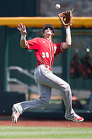 North Carolina State outfielder Jake Fincher (30) makes a running catch during Game 3 of the 2013 Men's College World Series between the North Carolina State Wolfpack and North Carolina Tar Heels at TD Ameritrade Park on June 16, 2013 in Omaha, Nebraska. The Wolfpack defeated the Tar Heels 8-1. (Andrew Woolley/Four Seam Images)