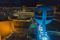 Las Vegas, Nevada.  On the High Roller at Night.  Treasure Island, Venetian and Harrah's Hotels and casinos below.