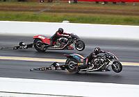 Mar 17, 2019; Gainesville, FL, USA; NNHRA top fuel Harley Davidson nitro motorcycle rider Rickey House (near) does a wheelstand alongside Doug Vancil during the Gatornationals at Gainesville Raceway. Mandatory Credit: Mark J. Rebilas-USA TODAY Sports