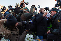 Moscow, Russia, 15/12/2012..Opposition leader Sergei Udaltsov waves a poster reading ?Russia will be free? in a policeman's face as he is arrested beside a memorial to KGB victims in Lubyanka Square at an unauthorised opposition rally to mark a year of protests against Vladimir Putin.