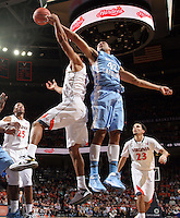 during an NCAA basketball game against Virginia Monday Jan. 20, 2014 in Charlottesville, VA. Virginia defeated North Carolina 76-61. North Carolina forward Joel James (42) reaches for the rebound next to Virginia guard Malcolm Brogdon (15)