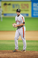 Aberdeen Ironbirds relief pitcher Steven Klimek (28) gets ready to deliver a pitch during a game against the Batavia Muckdogs on July 14, 2016 at Dwyer Stadium in Batavia, New York.  Aberdeen defeated Batavia 8-2. (Mike Janes/Four Seam Images)