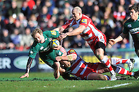Matthew Tait is tackled to ground. Aviva Premiership match, between Leicester Tigers and Gloucester Rugby on February 16, 2014 at Welford Road in Leicester, England. Photo by: Patrick Khachfe / JMP